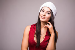 Portrait of beauty woman in red dress and Christmas santa hat Stock Photos