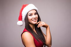 Portrait of beauty woman in red dress and Christmas santa hat Royalty Free Stock Photography