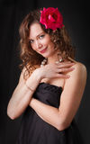 Portrait of beauty woman with red flower. Glamor Portrait of beauty woman with red flower royalty free stock photography
