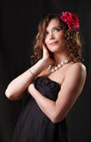 Portrait of beauty woman with red flower. Glamor Portrait of beauty woman with red flower royalty free stock photos