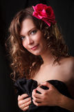 Portrait of beauty woman with red flower. Glamor Portrait of beauty woman with red flower royalty free stock images