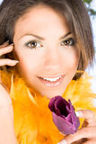 Portrait of a beauty woman with a violet tulip Royalty Free Stock Photography