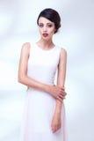 Portrait of beauty woman in white dress Stock Image