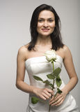 Portrait of beauty woman with white rose in white dress Stock Photo