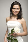 Portrait of beauty woman with white rose in white dress Royalty Free Stock Photography