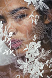 Portrait of beauty young afro woman through white lace Stock Image