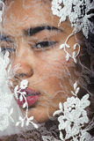 Portrait of beauty young afro woman through white lace Stock Photos