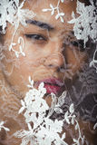 Portrait of beauty young afro woman through white lace Royalty Free Stock Photography