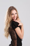 Portrait of the beauty young blond girl in black Royalty Free Stock Photography