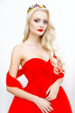 Portrait of beauty young blond girl with red lips. Beauty young queen long blond hair crown on her head. Portrait of beauty young blond girl with red lips Stock Photo