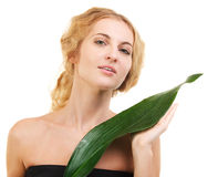 Portrait of the beauty young blond woman with green leaf Stock Photos