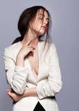 Portrait of beauty young brunette woman portrait in white fashion female jacket stock photo