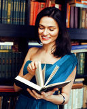 Portrait of beauty young brunette woman reading book in library smiling, muslim girl in education, lifestyle people Stock Photos