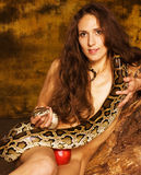Portrait of beauty young lady with snake and red apple Stock Photos