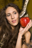 Portrait of beauty young lady with snake and red apple Royalty Free Stock Photo