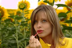 Portrait of beauty young woman applying lipstick Royalty Free Stock Photography