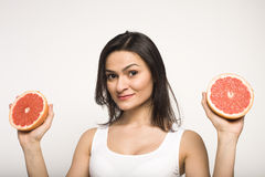 Portrait of beauty young woman with grapefruit  Royalty Free Stock Photos