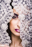 Portrait of beauty young woman through lace Stock Photo