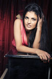 Portrait of beauty young woman laying on piano Royalty Free Stock Image