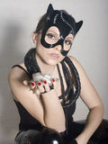 Portrait of beauty young woman in mask like cat in white box Stock Image