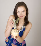 Portrait of beauty young woman with moneybox isolated Royalty Free Stock Photography