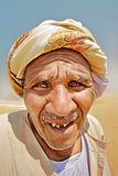Portrait of a bedouin. With a knotted arafat coat on his head Stock Images