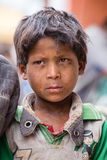 Portrait beggar young boy on the street in Leh, Ladakh. India Royalty Free Stock Images