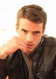 Portrait of beguiling man. Portrait of beguiling young man in black leather jacket Stock Image