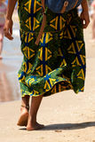 Behind of woman walking barefoot at the beach. Portrait from behind of woman walking barefoot at the beach Stock Images
