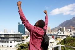 Young african man standing outdoors and arms raised Stock Photography