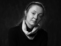 Portrait  of  bemused lady looking in the camera. Portrait of a young sad disoriented woman , grey background Royalty Free Stock Photo