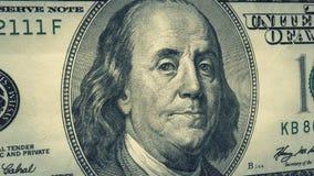 Portrait Benjamin Franklin on USA money One hundred dollars banknote pile. Background royalty free stock image