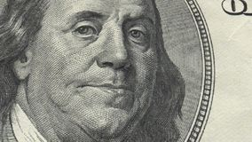 Portrait Benjamin Franklin on USA money One hundred dollars banknote pile stock photo