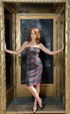 Portrait of beuatiful young woman with red hair in dress - fashion Stock Images