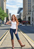 Portrait of beuatiful young woman with red hair in white shirt and denim Royalty Free Stock Images