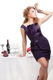 Portrait of beutiful woman standing nea table Stock Image