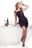Portrait of beutiful woman standing nea table Stock Photos