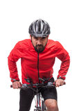 Portrait of  bicyclist with helmet and red jacket, riding a bicycle,  on white Stock Image