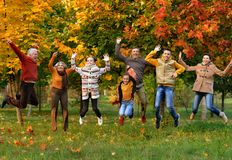 Big happy family. Portrait of big happy family in autumnal park royalty free stock photography