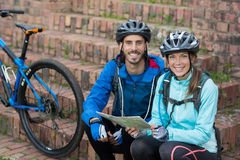 Portrait of biker couple with a map Stock Photo