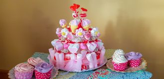 portrait of birthday party supplies. sweet corner with cake, lollies, cookies and candy royalty free stock photo