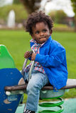 Portrait of a black baby playing Stock Photo