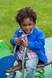 Portrait of a black baby playing. Outdoor portrait of a cute  black baby boy playing at playground Royalty Free Stock Images
