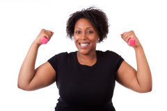 Portrait of a black fatty woman working out with free weights -. African people ,isolated on white background Stock Photos