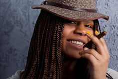 Portrait of a black girl with a cigar Royalty Free Stock Photos