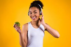 Portrait of black girl listening to music isolated stock photography