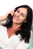 Black Haired Woman Talking On Phone Royalty Free Stock Photo