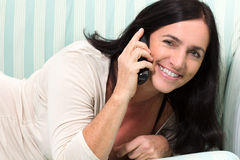 Black Haired Woman Talking On Phone Royalty Free Stock Image
