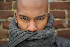 Portrait of a black male fashion model with gray scarf covering face Royalty Free Stock Photos