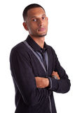 Portrait of a black man with folded arms. Portrait of a young african american man with folded arms, isolated on white background Stock Image
